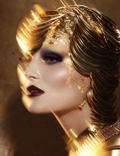 Golden Mermaid by Youth Vision Magazine From the beauty of the depths of the unknown abyss, the stunning photography of the Golden Mermaid by Youth Vision Magazine editorial spread captures a large amount of beauty snaps. The visionary masterpiece of photographer Paco Peregrín invigorates the dark hued lips, red eye shadow and porcelain skin of a sunken mermaid.