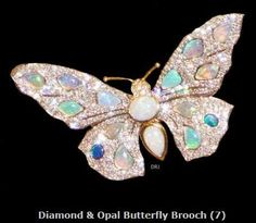 Queen Emma . Butterfly set with diamonds and Opals.