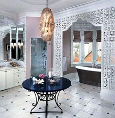 Roman blinds are perfect as the window treatment in this fabulous Moorish bathroom as they leave the bay window floor area free for the bath. #interior design #bathrooms #blinds
