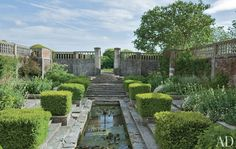 In the sunken garden, rows of boxwood line a lily pond. Robert Couturier