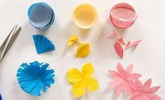 Die zarten Blüten waren ursprünglich ganz einfache Muffinförmchen aus Papier! Wie daraus ein Blumenkranz wird, erklären wir Ihnen in wenigen Schritten.