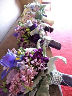 """bridesmaids bouquets all in a row--and a little bit of """"bling"""" for the ladies"""
