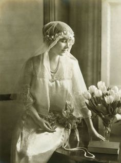 Lady Elizabeth Bowes Lyon in the dress she wore as a bridesmaid at the marriage of HRH Princess Mary and Viscount Lascelles, 28 February 1922. Discover her ancestors in A Right Royal Scandal: Two Marriages That Changed History. http://www.pen-and-sword.co.uk/A-Right-Royal-Scandal-Hardback/p/12374/?aid=1156