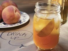 Peach Texas Tea from Dinner at Tiffani's:      One 1-inch piece ginger, peeled     5 black tea bags     1/4 cup sugar     1 1/2 cups peach nectar      3/4 cup tequila     2 tablespoons lime juice     Peach slices, for garnish     Ice, for serving Boil ginger and tea to let steep.