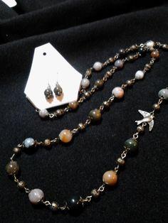 Polished stone and bronze bird necklace set