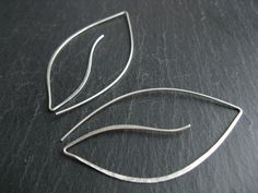 Silver Moon leaves, modern oversized leaf shaped earrings, contemporary organic style. £22.00, via Etsy.