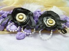 Handmade Black Lolly pop Flowers with white and gold vintage button center