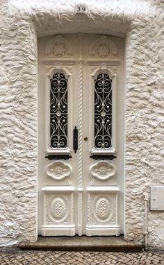 White Entrance with Carved White Door in Portimão, Faro, Portugal Cool Doors, Unique Doors, Entrance Doors, Doorway, Single Wooden Door Designs, Art Nouveau, Art Deco, Doors Galore, Door Gate