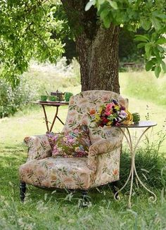 We all know that an indoor, fabric covered chair can't live long in the great outdoors, but the idea of it is so romantic!