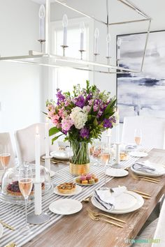 A gorgeous formal brunch tablescape, showcasing just how versatile the Olivia and Oliver dinnerware collection from Bed Bath & Beyond can be! I love the striped table runner, gold flatware, velvet-trimmed napkins, and long stemmed champagne glasses. French Country Farmhouse, French Country Decorating, Farmhouse Decor, Modern Farmhouse, Decoration Table, Table Centerpieces, Beautiful Home Gardens, Table Setting Inspiration, Design Inspiration