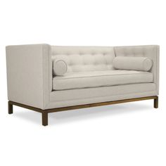Loveseat | Jonathan Adler :Swanky and cozy, our Lampert Loveseat exudes Hollywood glamour on a tailored scale. Perfect for entertaining – or fainting spells – this loveseat is the cornerstone of any elegantly functional room. The high tuxedo back gives a formal spirit, but is perfectly comfy for watching TV. The bolsters add graphic punch and provide the perfect armrest. Slim proportions add a couture, decorator-ish spirit.