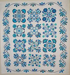 Aunt Millie's Garden quilt made in blues and white by Jan McPike.  Piece O Cake Designs.