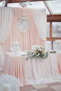 Now thats a space that grabs your eye. The feminine touches and soft peach color will immediately attract their idea client.