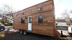 The Big Skye from Normadic Cabins; a 320 sq ft tiny house with two bedrooms, a full kitchen, bathroom, and even a dog cave!