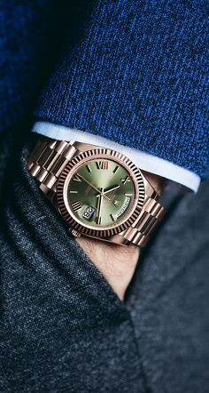 The Rolex Day-Date 40, on the wrist of Roger Federer.