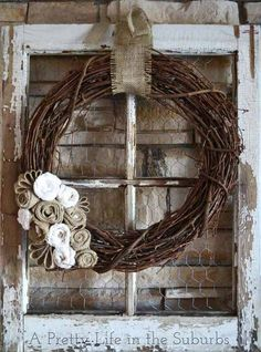 Love the grapevine wreath on the old window!