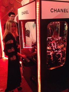 Rachel Zoe @ a Chanel  vending machine .... This must be in heaven somewhere.