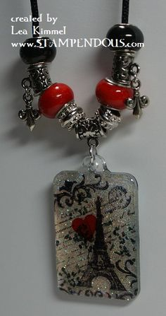 Created with Charm Collection stamps and resin from EnviroTex.