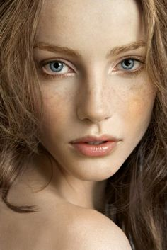 Everything about her was soft - the loose curls of dust-colored hair, the golden freckles, the slightly parted lips and the big, open eyes.