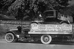 Truck carries a Chevrolet Coupe Advertisement with an actual vehicle on board