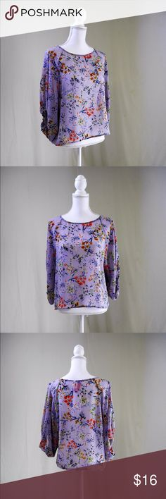 Sheer Floral Blouse This gorgeous lavender top will make it feel like spring time all year round. Lightweight and flowy, it's not only cute, it's flattering. Tops Blouses