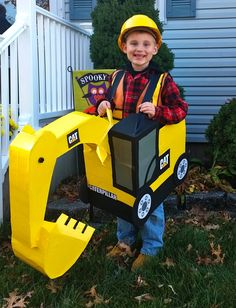 Halloween costume cardboard excavator: My son wanted to be a constructon worker but wanted an excavator as well. So I made it using cardboard and alot of patience! It was all worth it because he had fun! I purchased a hard hat at Home Depot, ordered the safety vest at birthdayexpress.com added a flannel shirt, jeans and work boots to complete the look.