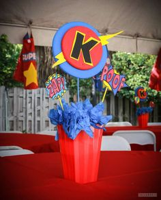 Superhero birthday party table centerpiece!  See more party planning ideas at CatchMyParty.com!