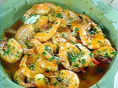 Tapas recipes. http://www.foodnetwork.com/recipes/bobby-flay/oven-roasted-shrimp-with-toasted-garlic-and-red-chile-oil-recipe/index.html
