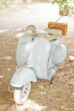 White | White Vespa with wicker basket in the summer shade
