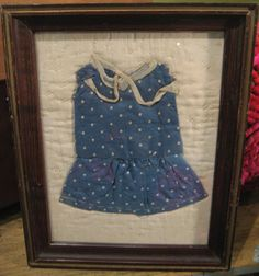 I have some precious doll clothes that my Great Grandmother made.  I may frame them for the guest room.  (via 52 FLEA)