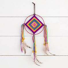 """5.75"""" wide Handmade God's Eye Dream Catcher with yarn middle and fabric wrapped hoop. Embellished with ribbon, suede, feathers and beads. Makes a perfect gift!"""