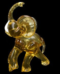 """Monumental Ercole Barovier Elephant! Date1930s Dimensions 7"""" H x 3.15"""" width L 5.12"""" H:20cm Width: 8cm L: 13.5cm DescriptionLegendary elephant, hand blown in Murano by glass Master Ercole Barovier in the 1930s. Amber glass, white tusks, white eyes with red pupils. Charecteristic detail to the trunk. Raised trunk for luck!"""