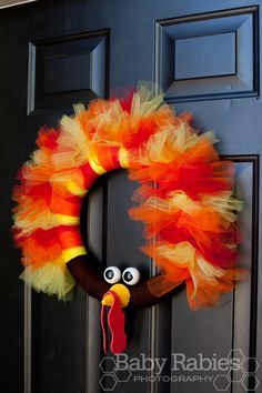 Too late for this year but next year's Thanksgiving wreath for sure!  Looks like the turkey is wearing a tutu!  Love it!