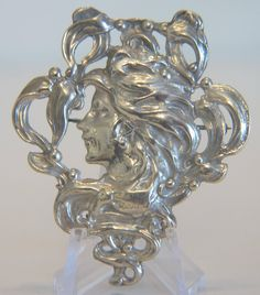 Art Nouveau silver brooch depicting the profile of a young woman. The brooch is fine crafted with open work technique  and is a beautiful example of