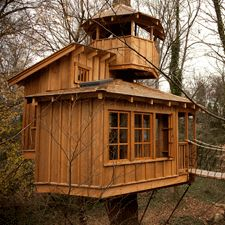 Tree house - Built for a lucky set of children. A favorite aspect of this tree house is the crow's nest perched above the structure for the truly adventurous! Building A Treehouse, Building A House, Treehouse Living, Cabana, Cool Tree Houses, Tree House Designs, Crow's Nest, Cabins And Cottages, Tree Tops