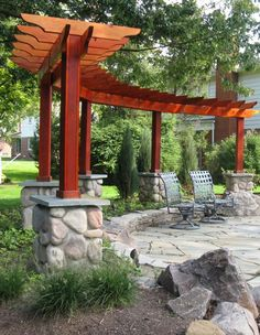 different shaped pergola .. makes a nice backdrop for the fire pit :) #pergolafirepitideas