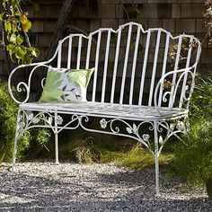 Accentuate your classic garden with this beautiful antique white iron bench with ivy leaves and delicate scroll details.
