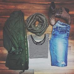 Military jacket, striped shirt, scarf, jeans and booties