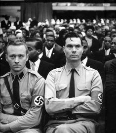 Eve Arnold, George Lincoln Rockwell flanked by members of the American Nazi Party at Black Muslim meeting, 1961. Magnum Photos