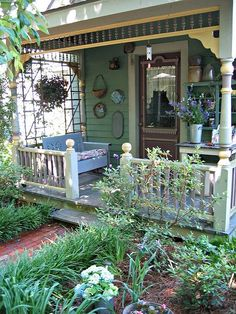 Love porches like this. They are a world (and a room) of their own.