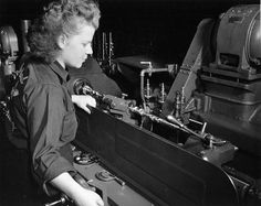 Thirty percent of Packard war workers were women. This worker operating a lathe is contributing to the production of Rolls-Royce Merlin aircraft engines. (Automotive Council for War Production Collection, National Automotive History Collection, Detroit Public Library)