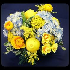 When life sends you a lemon...  We made lemonade with this mix of hydrangea, ranunculus, daffodils, mimosa and freesia.  Roberts Flowers of Hanover, Hanover, NH