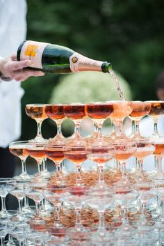 Vintage glam wedding idea: Rose gold Champagne tower.