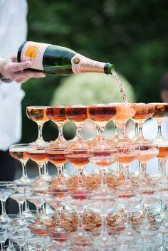 Vintage glam wedding idea: Rose gold Champagne tower.