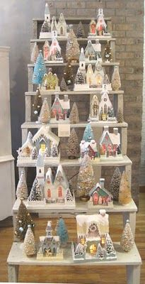 great way to display old cardboard Christmas houses and bottle brush trees...love  Curious Sofa Diaries