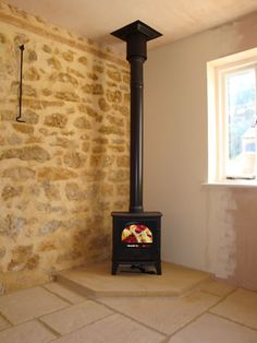 Contura 51L wood burning stove in neat corner fireplace made