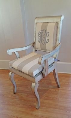Bespoke dining chair in silver leaf finish with monogram detail