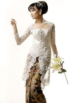 Lovely traditional kebaya dress. The top is often embellished with embroidery and/or beadwork while the bottom is a full length batik or silk skirt.
