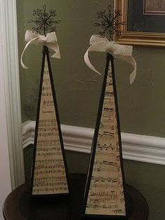 love these - kind of have a tree thing. :) Styrofoam cone covered with sheet music  and tree topper on top.