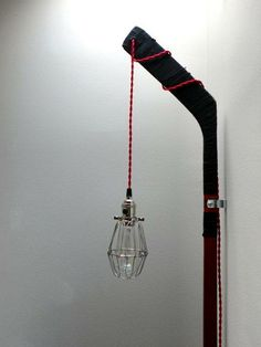 This item is unavailable Vintage Hockey Stick Cage Light - red cloth twisted cord, wall mount, plug-in Hockey Stick Crafts, Hockey Sticks, Hockey Mom, Ice Hockey, Boys Hockey Room, Hockey Bedroom, Hockey Decor, Cage Light, Boy Room